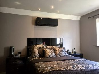 All black matching bedroom air conditioning