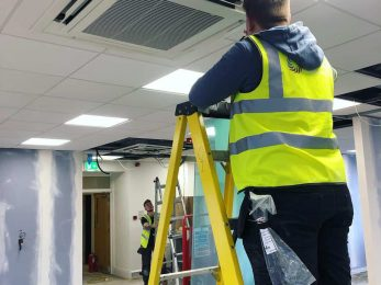 Chill Air engineer installing the finishing touches to office air conditioning