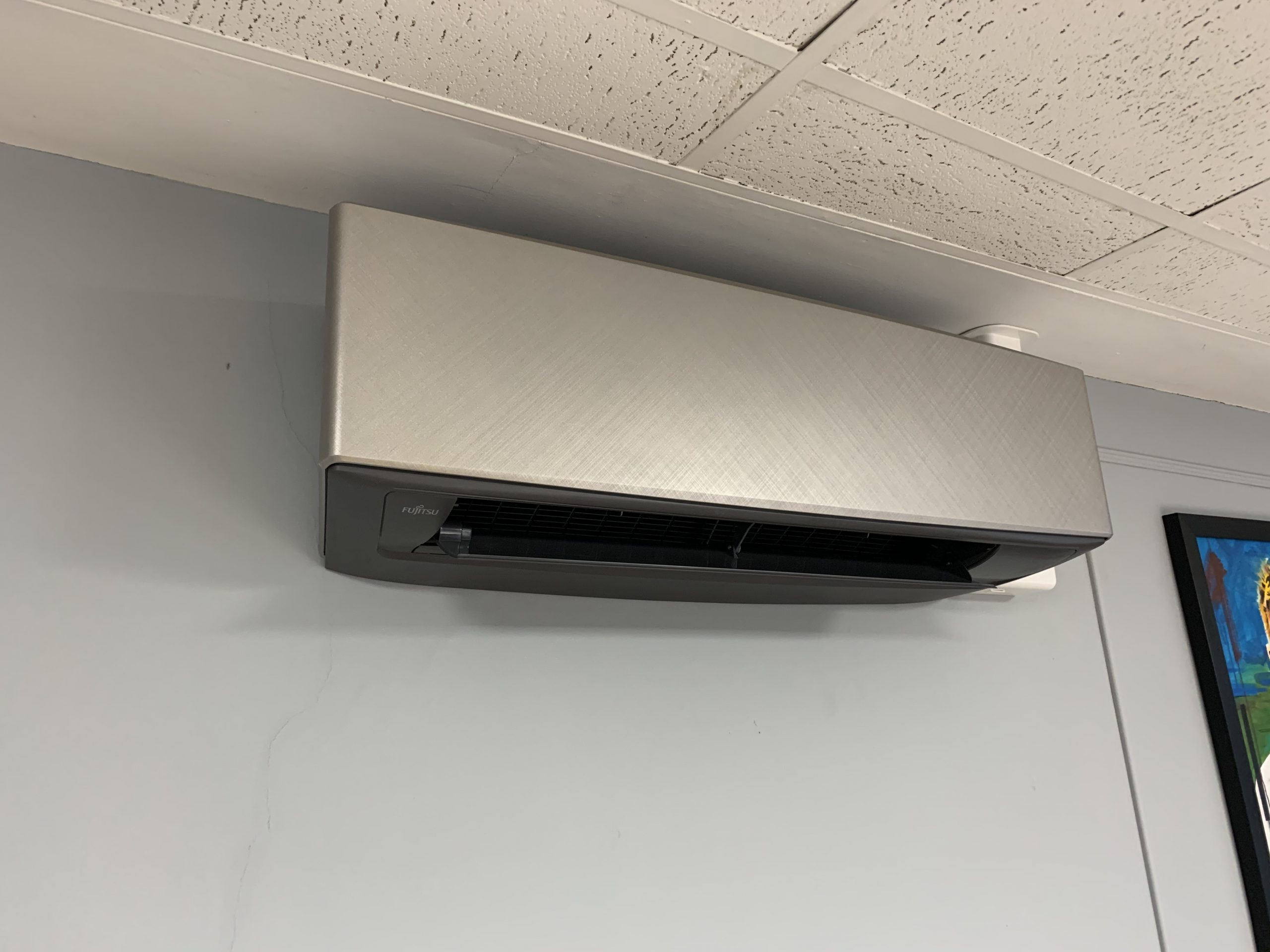 Silver Fujitsu wall mount